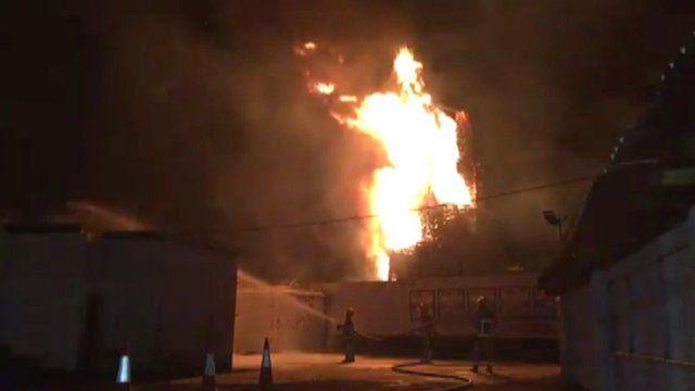 Fire crews sprayed foam over neighbouring properties as the Chobham Street bonfire is lit