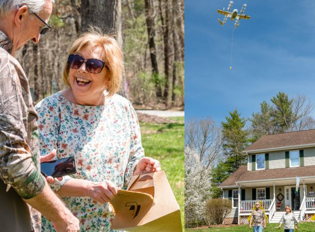 Couple holding package delivered by drone