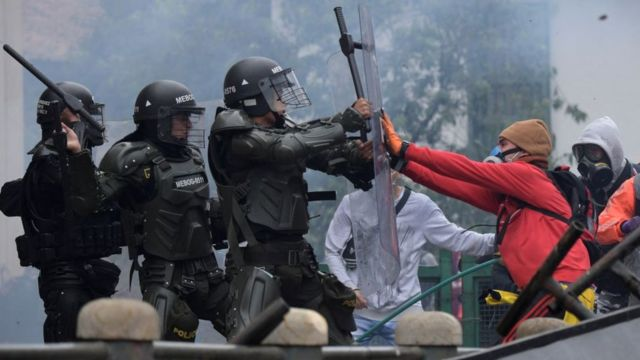 A confrontation between police and protesters in Colombia