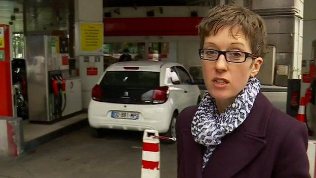 Lucy Williamson at a petrol station forecourt