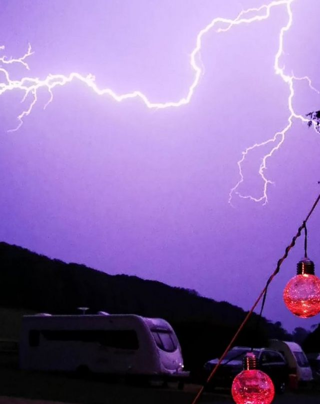 Lightning across the sky at Swiss Farm touring and camping
