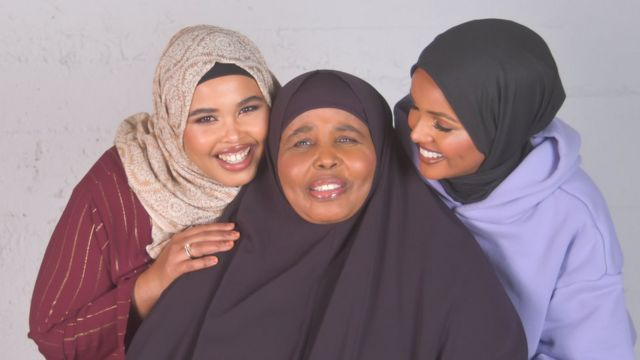 Halima Aden with her mum and sister Fadumo Aden