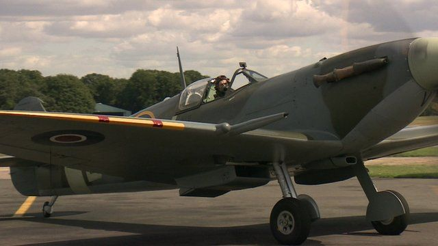Pilot in the cockpit of a Spitfire as preparations take place for an RAF flypast marking the Battle of Britain's 'hardest day'