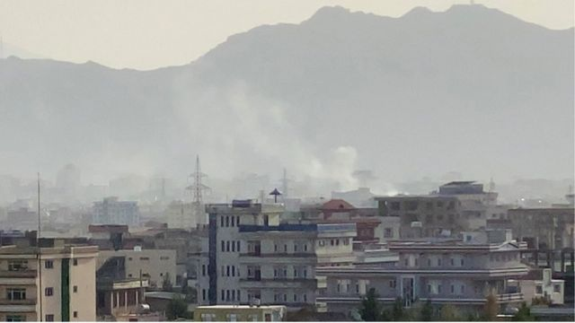 Smoke billows at the scene following an explosion near the Hamid Karzai International Airport in Kabul, Afghanistan, 29 August 2021