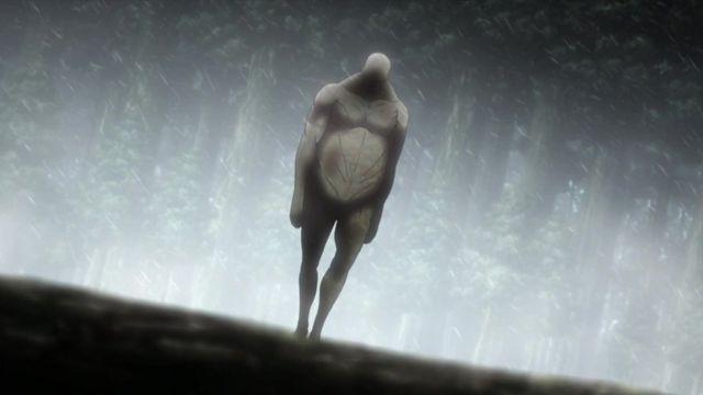 A Titan walks towards a village
