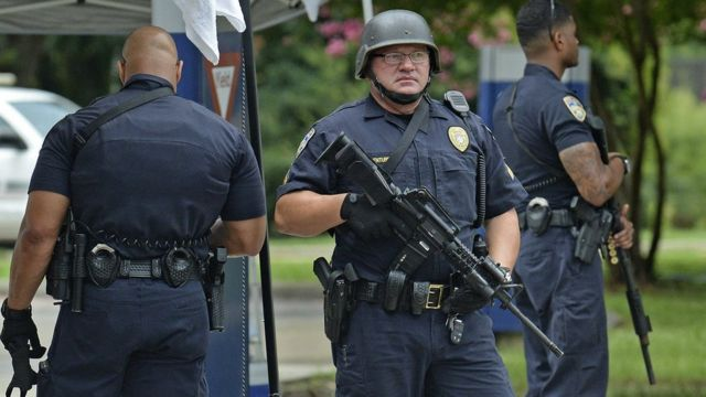 Baton Rouge Police stand at a checkpoint at the entrance of Our Lady Of The Lake Medical Center, Sunday, 17 July 2016, in Baton Rouge,