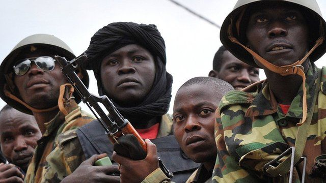 Former Seleka militants are escorted to a military camp outside the city of Kasai in 2014