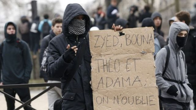 A youth holds a placard during the protests in Paris on Thursday (23 February 2017)