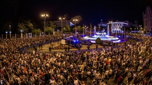 Real Madrid fans celebrate in Cibeles Square in Madrid