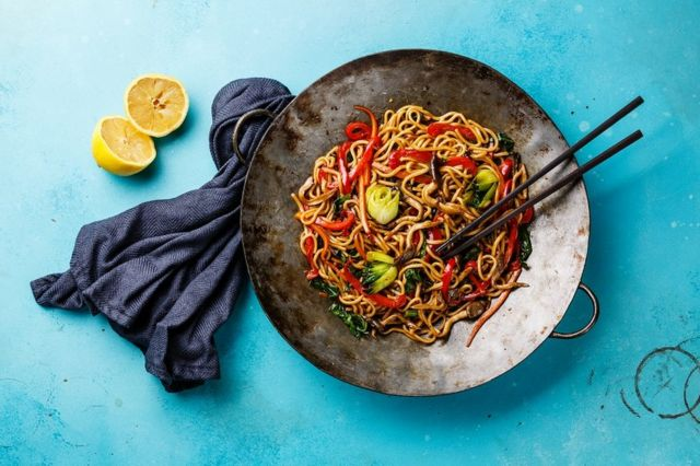 Udon stir fry noodles with oyster mushrooms and vegetables