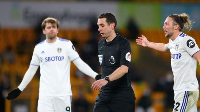 Leeds players react after having a goal disallowed against Wolves