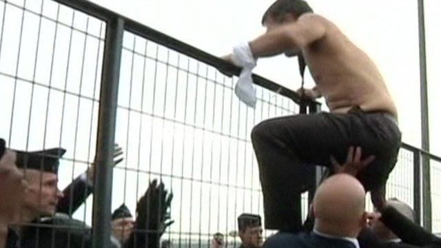 A shirtless Air France boss jumps over a fence