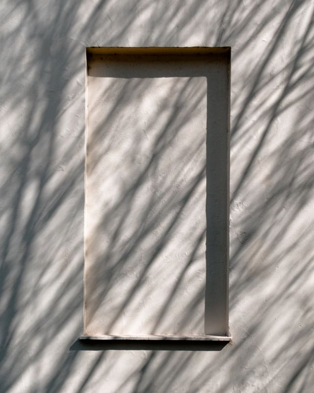 Shadows cast across a single blocked window in Bedford Place, London