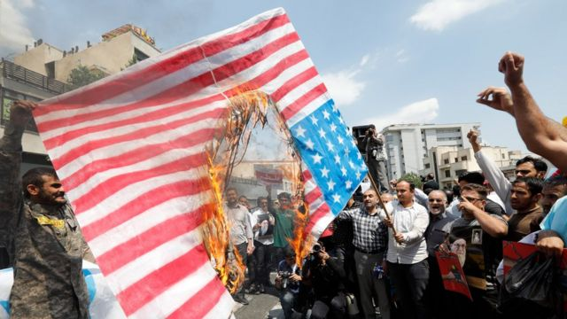 Iranians burn US and Israeli flags in Tehran, Iran, 18 May 2018