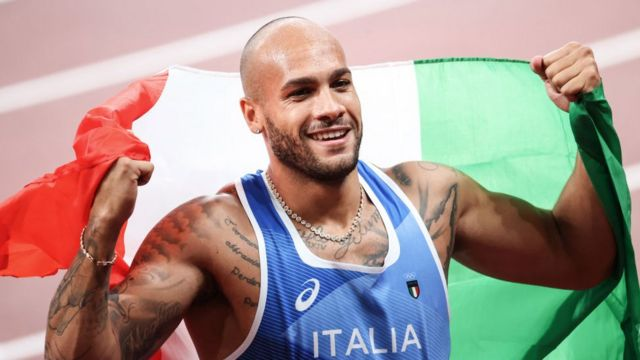 Italy's Lamont Marcell Jacobs celebrates after winning the men's 100m final during the Tokyo 2020 Olympic Games