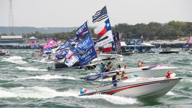 Boats take part in a parade of supporters of US President Donald Trump on Lake Travis near Lakeway