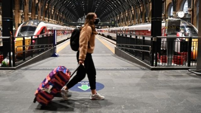 A commuter at Kings Cross Station in London