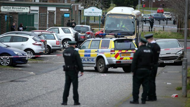 Police at the scene of the shooting outside St Brendan's Primary School in Craigavon