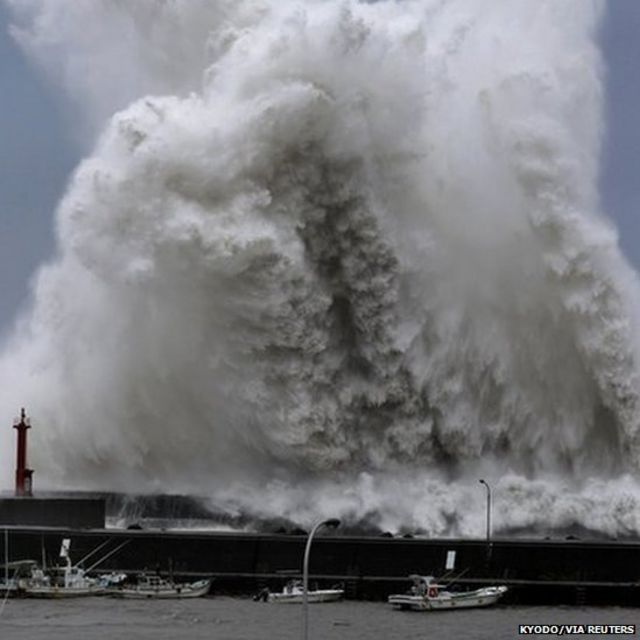 High waves breaking at a fishing port in Aki