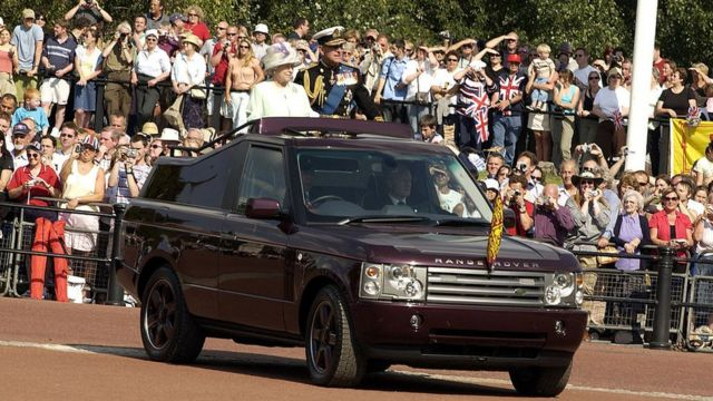Queen Elizabeth II of England and Prince Philip  Stamped on the back of a modified 2005 Range Rover.