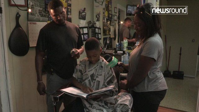 Child reads to his hairdresser