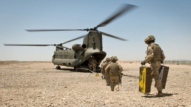Soldiers of 4 SCOTS Bn board a British CH-47 helicopter on 10 May 2014, the final morning of the British occupation of PB Sterga 2, as they prepare to leave the base for the final time.