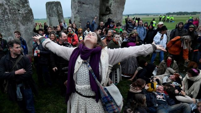Revellers gather to celebrate the Summer Solstice at Stonehenge ancient stone circle, despite official events being cancelled amid the spread of the coronavirus disease