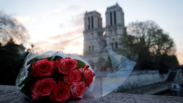 Flowers laid outside Notre-Dame cathedral in Paris, April 2019