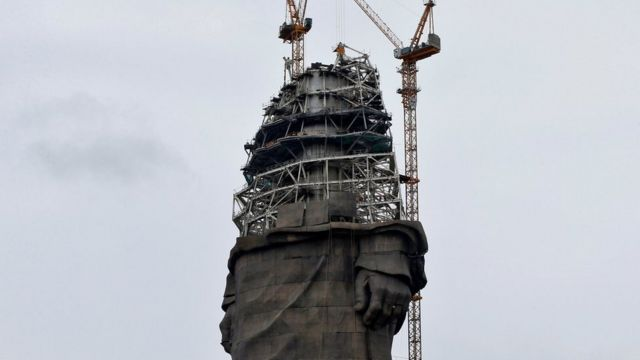 The statue to Sardar Vallabhbhai Patel under construction, with scaffolding and a crane in shot
