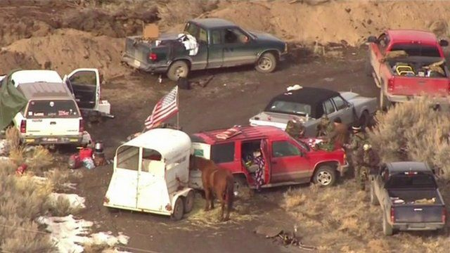Cars block the road to the occupied Malheur complex in Oregon