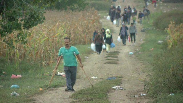 People trek through Croatian fields