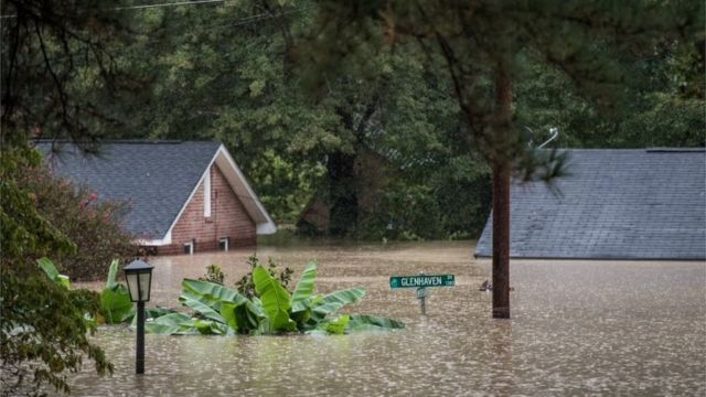 Carolina rainfall: Nine dead in 'unprecedented' flooding