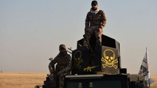 مسلحون تابعون لقوات الحشد الشعبي في العراق