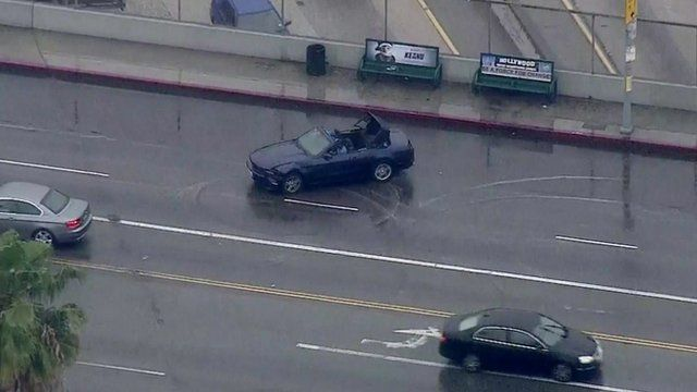 "Car doing ""doughnuts"" in Hollywood"