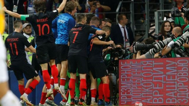 Croatian players celebrate the victory over England