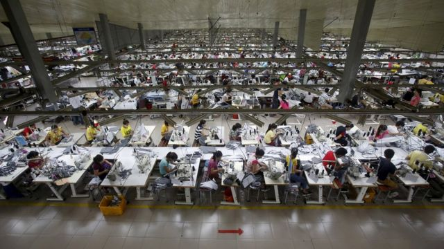 Labourers work at a garment factory in Bac Giang province, near Hanoi October 21, 2015.
