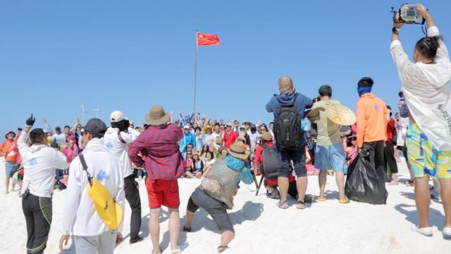 Flag raising ceremony on Quanfu Island, Paracel Islands.