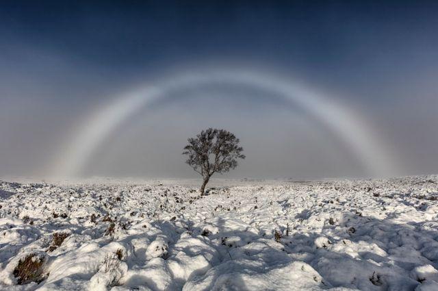 Amazing white rainbow snapped over Scottish moor