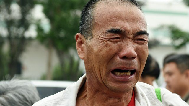 A relative of a passenger on missing Malaysia Airlines MH370 cries while waiting for an expected meeting with Malaysian officials