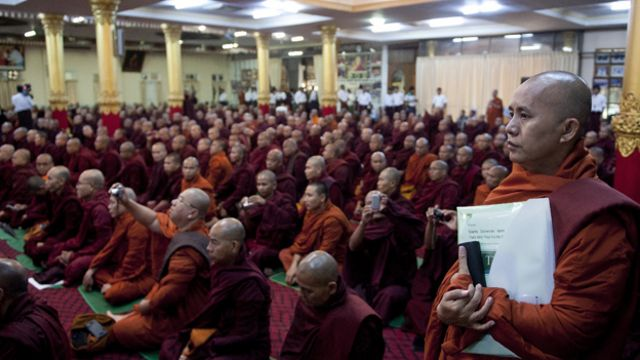 Controversial Myanmar monk Wirathu (R) attends a meeting of Buddhist monks at a monastery outside Yangon on June 27, 2013. Buddhist monks met in Yangon to discuss a controversial proposal for a nationality law to restrict marriages between Buddhist women and men of other faiths which comes after outbreaks of deadly religious unrest.