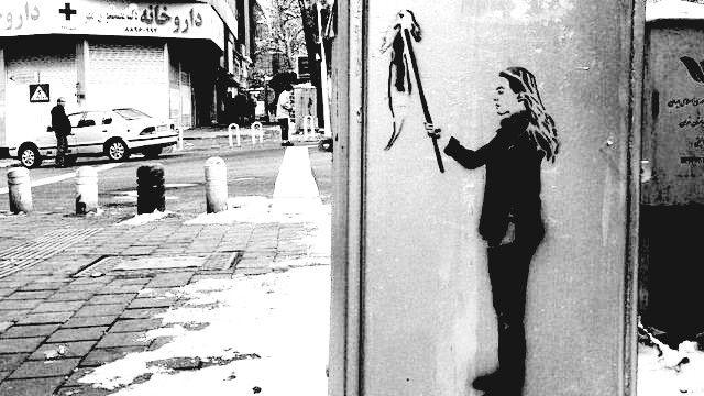 گرافیتی دختران خیابان انقلاب در اعتراض به حجاب اجباری