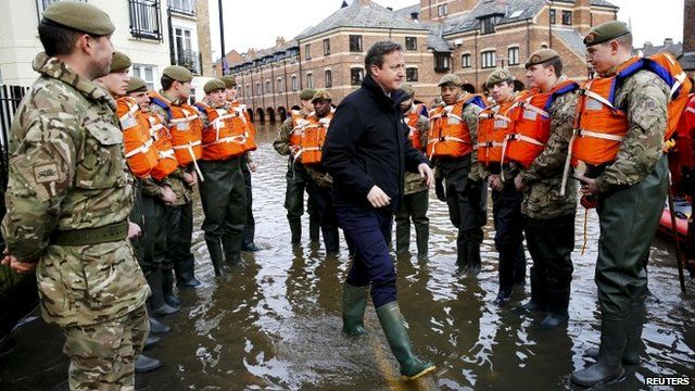 David Cameron greets soldiers working on flood relief in York city centre