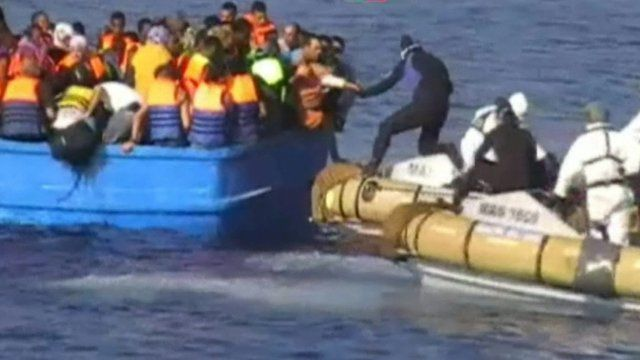 Italian Navy rescue migrants from a crowded boat off the coast of Libya