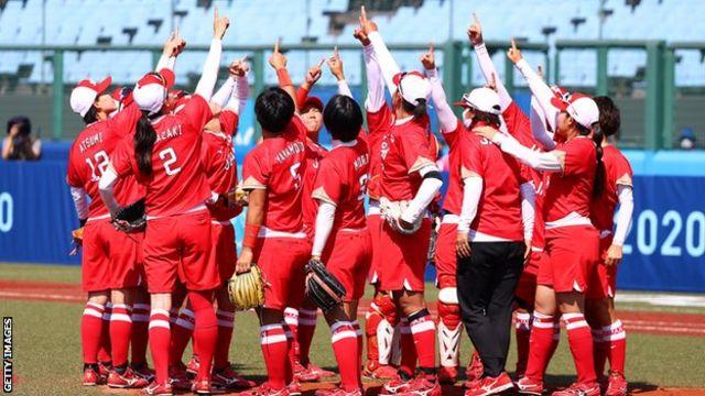 Team Japan celebrate their victory over Australia