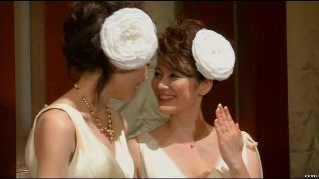 Hiroko Masuhara and Koyuki Higashi in wedding dresses