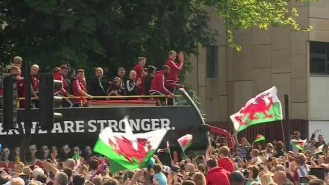 Wales football team bus moves through crowds