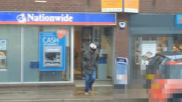 Robber leaving Nationwide