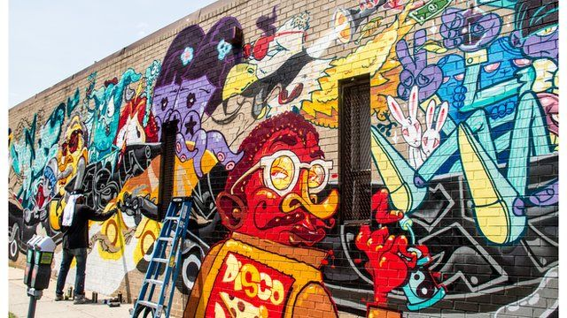 A mural by three international artists in downtown Washington DC