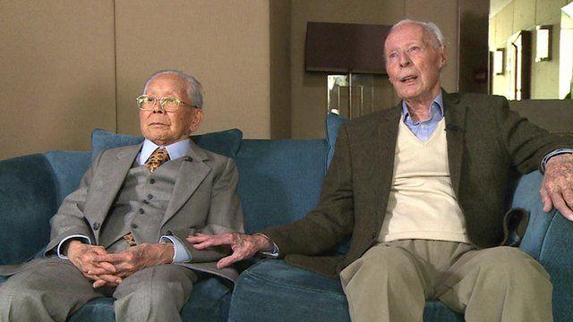 Sir Harold Atcherley & Mikio Kinoshita sat side-by-side.