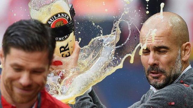 Pep Guardiola celebrates with giant beer